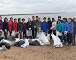 图:参加清理海滩的狮会义工们合影。(爱市狮会提供)