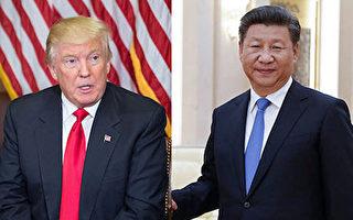 """就在外界担忧朝鲜25日再次进行核试验之际,川普(特朗普)24日与习近平再次通话,商谈朝核问题。外界认为,这次通话显得非同寻常,或有精心安排的""""玄机""""( NICHOLAS KAMM/AFP/Getty Images)"""