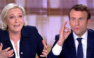 5月3日法国大选候选人勒庞和马克龙举行电视直播辩论。( AFP PHOTO / STRINGER)