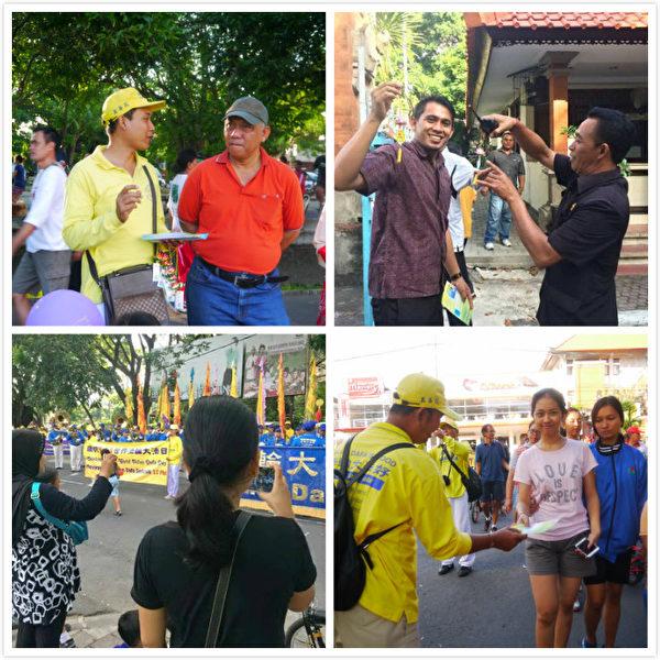 巴厘島法輪功學員慶祝李洪志先生六十六歲華誕暨世界法輪大法日。巴厘島法輪功學員發真相傳單,民眾用手機錄制現場游行視頻。(蕭律生/大紀元)