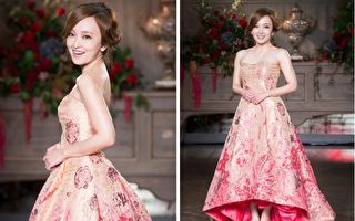 愛紗5月23日在台北出席活動,以一身粉桃色婚紗亮相。(陳柏州/大紀元)