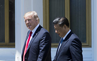 """Vox分析,川普之所以对朝鲜""""态度转变"""",乃是处于战略考虑,因为现在遏制朝鲜的野心和疯狂行动,才是他的当务之急。    ( JIM WATSON/AFP/Getty Images)"""