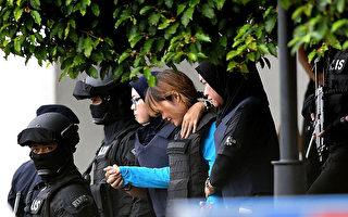 4月13日上午,段氏香(中)身穿防弹衣,在大量警员戒备中第二次出庭受审。(MANAN VATSYAYANA/AFP/Getty Images)