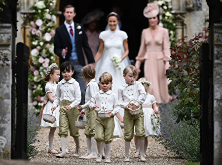 ENGLEFIELD GREEN, ENGLAND - MAY 20: Pageboy Prince George of Cambridge leads the bridesmaids and pageboys out of church after his aunt Pippa Middleton marries James Matthews following their wedding ceremony at St Mark's Church on May 20, 2017 in Englefield Green, England. (Photo by Justin Tallis - WPA Pool/Getty Images)