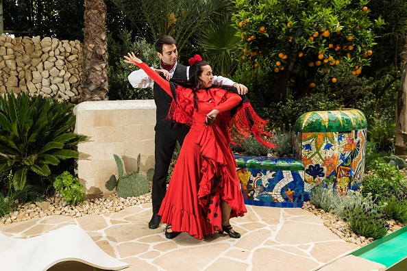 LONDON, ENGLAND - MAY 22: Traditional Spanish flamenco dancers perform at the RHS Chelsea Flower Show on May 22, 2017 in London, United Kingdom. Created by multi award winning designer, Sarah Eberle, the garden was inspired by the art, architecture and colours of Barcelona, one of Viking Cruises' most popular destinations. (Photo by Ian Gavan/Getty Images for Viking Cruises)