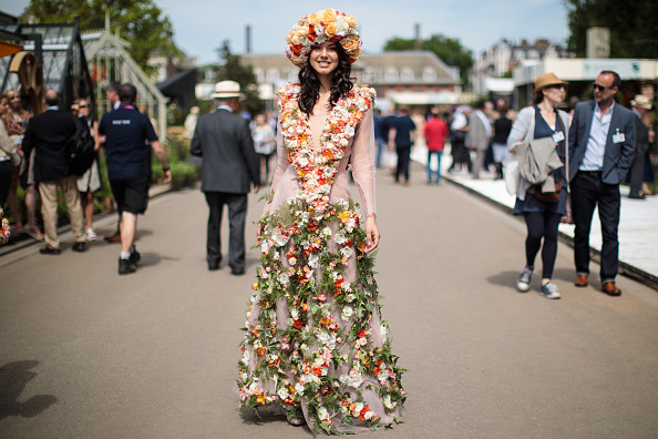 LONDON, ENGLAND - MAY 22: A woman wearing an outfit decorated with flowers poses at the Chelsea Flower Show on May 22, 2017 in London, England. The prestigious Chelsea Flower Show, held annually since 1913 in the Royal Hospital Chelsea grounds, is open to the public from the 23rd to the 27th of May, 2017. (Photo by Jack Taylor/Getty Images)