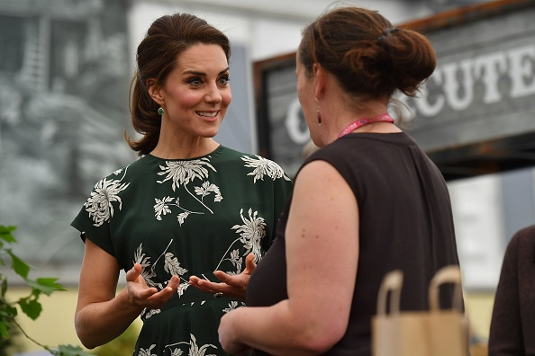 Britain's Catherine, Duchess of Cambridge (L), talks to an exhibitor as she visits the Chelsea Flower Show in London on May 22, 2017. The Chelsea flower show, held annually in the grounds of the Royal Hospital Chelsea, opens to the public this year from May 22. / AFP PHOTO / POOL AND AFP PHOTO / Ben STANSALL (Photo credit should read BEN STANSALL/AFP/Getty Images)