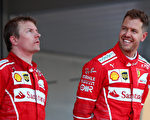F1摩纳哥站,法拉利车手维特尔(右)凭借进站策略,超过杆位发车的队友莱科宁(左)夺得冠军。(Dan Istitene/Getty Images)