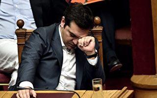 希臘總理齊普拉斯(Alexis Tsipras)近年兩次訪問中國,希望吸引投資者到陷於經濟困境的希臘投資。 (ARIS MESSINIS/AFP/Getty Images)