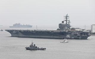 美航空母舰卡尔文森号与里根号两支航母战斗群,最近在朝鲜半岛以东的日本海联合演习。图为5月16日,里根号驶离横须贺军港,进入日本海开始巡视附近水域。(STR/JIJI PRESS/AFP)