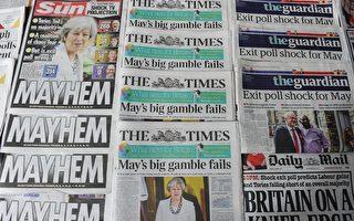 2017年6月9日,英國日報首頁報導有關大選的投票結果。(DANIEL SORABJI/AFP/Getty Images)