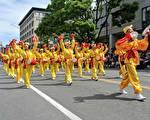溫哥華部分法輪功學員參加加拿大卑詩省維多利亞日150周年慶典遊行。(明慧網)