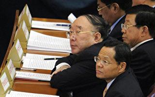 黃奇帆(中)被指是薄熙來的同黨,涉嫌薄周政變。 (LIU JIN/AFP/Getty Images)