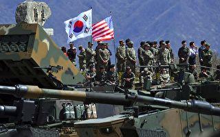 瓦姆比爾去世以及朝鮮再測試火箭引擎後,美軍加速部署,喊出「準備今晚開戰」口號;中方相應在東北邊境部署空降兵;這意味著美中等各方對朝鮮軍事行動的部署已在進行之中。日本戰後70多年來,與美方關係密切的日本政府首次出面播放朝鮮導彈襲擊避難公告;進一步佐證了朝鮮半島戰爭危機或迫在眉睫。(JUNG YEON-JE/AFP/Getty Images)