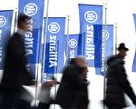 安聯保險公司計劃未來三年裡裁員700人。 (CHRISTOF STACHE/AFP/Getty Images)