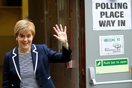 Scotland's First Minister and leader of the Scottish National Party (SNP), Nicola Sturgeon, gestures as she leaves a Polling Station after casting her ballot paper, in Glasgow, Scotland, on June 8, 2017, as Britain holds a general election. As polling stations across Britain open on Thursday, opinion polls show the outcome of the general election could be a lot tighter than had been predicted when Prime Minister Theresa May announced the vote six weeks ago. / AFP PHOTO / Andy Buchanan (Photo credit should read ANDY BUCHANAN/AFP/Getty Images)