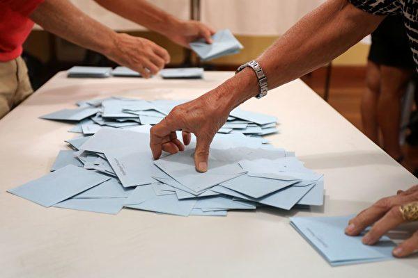 法国于周日举行第二轮国民议会选举。( RICHARD BOUHET/AFP/Getty Images)