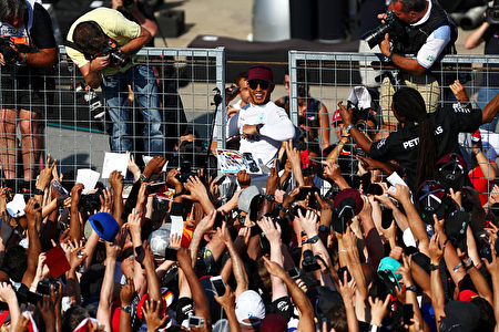 MONTREAL, QC - JUNE 11: Lewis Hamilton of Great Britain and Mercedes GP celebrates with the fans on the pit straight after winning the Canadian Formula One Grand Prix at Circuit Gilles Villeneuve on June 11, 2017 in Montreal, Canada. (Photo by Dan Istitene/Getty Images)