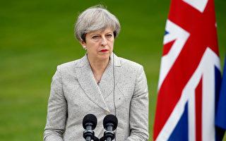 英國首相梅日前訪問巴黎,圖片攝於6月13日的巴黎記者會上。Thierry Chesnot/Getty Images)