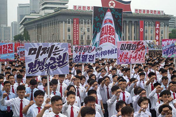 每一年,都有數百名美國人付錢去朝鮮旅行,一個地球上統治最嚴厲的國家。 ( KIM WON-JIN/AFP/Getty Images)