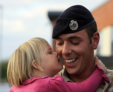 TIDWORTH, ENGLAND - SEPTEMBER 20: Sapper Russell Kirkham from 33 Armoured Engineer Squadron is welcomed home by his daughter Kaitlyn, 3, at Swinton Barracks, Perham Down, on September 20, 2009 in Tidworth, England. 33 Armoured Engineer Squadron have just returned from operations in Afghanistan after a six month tour of duty during which time they have taken part in some of the bloodiest fighting of the campaign so far, playing a key role in the recent Operation Panther's Claw. (Photo by Matt Cardy/Getty Images)
