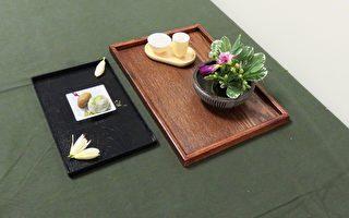 6月6日,茶藝種子教學培訓班進入茶席篇,圖為示範的茶花、茶器與茶食。(袁玫/大紀元)