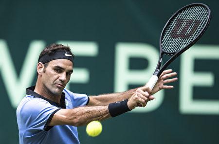 现年35岁的费德勒今年决赛胜率为100%,已成为本届温网的最大热门。 (Lars Baron/Bongarts/Getty Images)