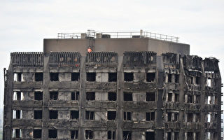 警方:伦敦高楼大火至少58人死亡