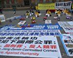 2017年7月20日夜,丹麦法轮功学员在首都市政厅前,点燃蜡烛,追悼在中共18年残酷迫害中失去生命的中国法轮功学员。(林达/大纪元)