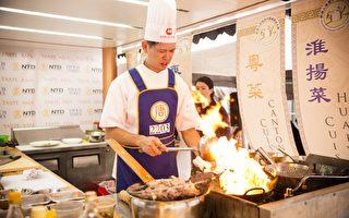 """越来越多从事餐饮行业的华人不再满足于给食客提供改良中餐,而是努力把地道的中华美食展现给西方世界。图为2015年6月27日,来自加拿大的温禧明参加第七届新唐人全世界中国菜厨技大赛决赛中,以粤菜""""葱爆牛肉""""赢得评委佳评。(爱德华/大纪元)"""