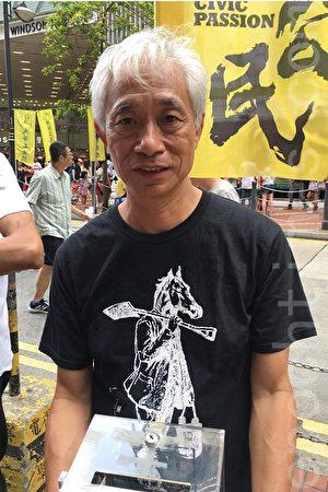 街工立法會梁耀忠表示,習近平出席就職典禮對中國的影響非常大,對香港的前景也很重要。(黃瑞秋/大紀元)