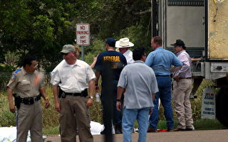 VICTORIA, TEXAS - MAY 14:  City and state discuss the deceased illegal immigrants found May 14, 2003 in Victoria, Texas.  The bodies of 18 immigrant were discovered in and around an 18-wheel truck in the early morning hours May 14 by a truck stop.  (Photo by Kerri L. Spires/Getty Images)