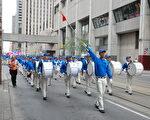 7月21日,加拿大东部近千法轮功学中聚集多伦多,举行集会和游行,纪念反迫害18周年。(伊铃/大纪元)