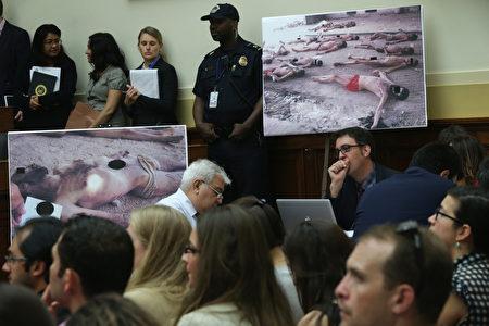 """从动用火烧皮肤、""""德国椅子""""刑罚到电击生殖器、强奸女性等,阿萨德就是用此类残忍手段来给数万名被关在监狱中的政治犯制造恐惧,让异己者失声。(Photo by Alex Wong/Getty Images)"""