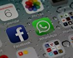 圖為facebook和旗下即時通訊軟體WhatsApp。 (Justin Sullivan/Getty Images)