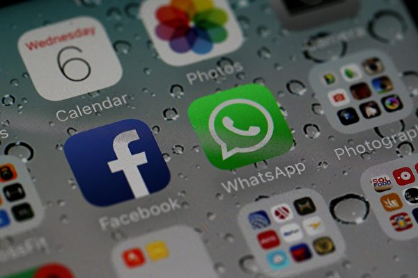 图为facebook和旗下即时通讯软体WhatsApp。 (Justin Sullivan/Getty Images)