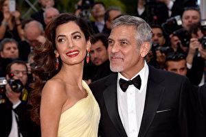 图为好莱坞影星乔治·克鲁尼和妻子阿马尔·克鲁尼。(Clemens Bilan/Getty Images)