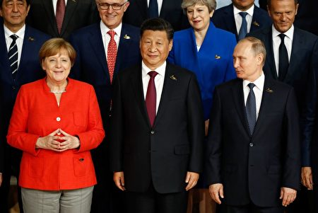 各國領導人在G20會議上照全家福。( Thomas Lohnes/Getty Images)