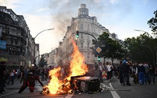 德國聯邦司法部長馬斯請求歐盟機構在查明G20峰會滋事的犯罪分子方面給予幫助。圖為漢堡G20峰會期間發生了暴力抗議事件。(Leon Neal/Getty Images)