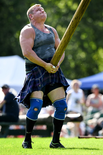 INVERARAY, SCOTLAND - JULY 18: Heavy weight competitors take part in the World Caber Tossing competition at Inveraray Highland Games on July 18, 2017 in Inverarary, Scotland. The Games celebrate Scottish culture and heritage with field and track events, piping, highland dancing competitions and heavy events including the world championships for tossing the caber. (Photo by Jeff J Mitchell/Getty Images)