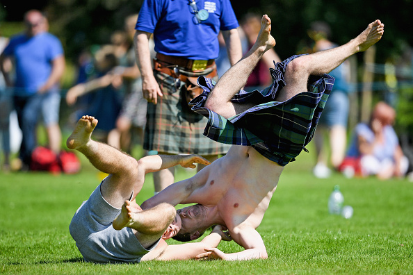 INVERARAY, SCOTLAND - JULY 18: Wrestlers compete at Inveraray Highland Games on July 18, 2017 in Inverarary, Scotland. The Games celebrate Scottish culture and heritage with field and track events, piping, highland dancing competitions and heavy events including the world championships for tossing the caber. (Photo by Jeff J Mitchell/Getty Images)
