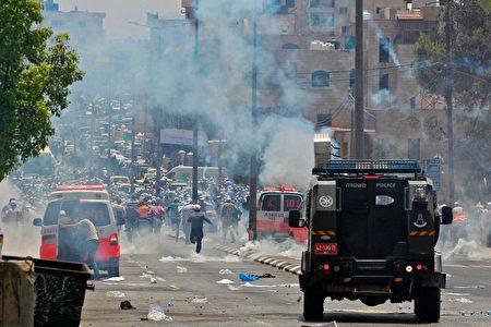 以色列和巴勒斯坦周五爆發近年最血腥衝突。(MUSA AL SHAER/AFP/Getty Images)