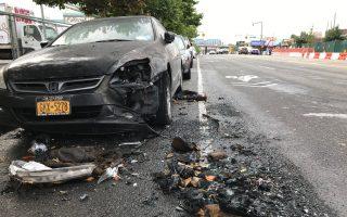 受殃及的車輛,車頭被毀,被燒毀的車輛留下一灘汽車碎片在地上。 (林丹/大紀元)