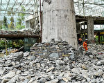 This photo taken on August 10, 2017 shows rescuers walking through the damaged InterContinental Resort Jiuzhai Paradise in Jiuzhaigou in China's southwestern Sichuan province, after an 6.5-magnitude earthquake struck the province late on August 8.  China on August 10 ramped up its response to an earthquake that killed 20 people and injured hundreds, sending supplies and personnel into the mountainous zone as rescuers fanned out to search for more victims. / AFP PHOTO / STR / China OUT        (Photo credit should read STR/AFP/Getty Images)