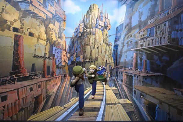 吉卜力特展中,《天空之城》男女主角在鐵軌上被海盜追殺的場景。(曾晏均/大紀元)