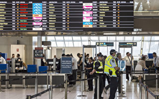SYDNEY, NEW SOUTH WALES - JULY 30:  Police guard the passenger security check area at Sydney Airport on July 30, 2017 in Sydney, Australia. Counter terrorism police raided four houses across Sydney on Saturday night and arrested four men over an alleged terror plot that involved blowing up an aircraft. Australian travellers have been warned to expect major delays at airports around the country with security screening measures ramped up following the raids.  (Photo by Brook Mitchell/Getty Images)