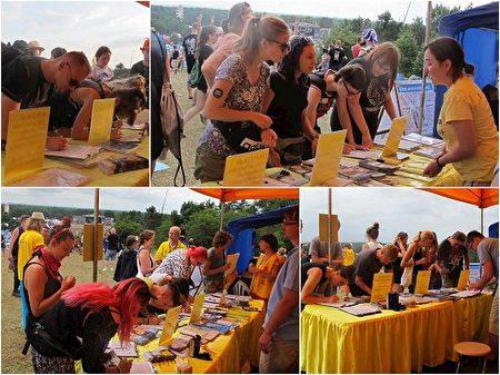 歐洲民眾在徵簽簿上簽名,反對中共對法輪功學員的活摘罪行(明慧網)