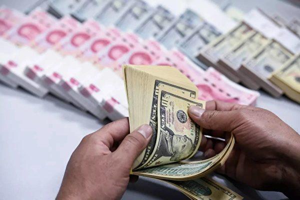 為控制大量資本外逃,北京當局加緊對收購海外公司的企業進行監管。(AFP)