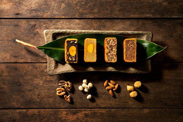理想大地月餅搭配「舞鶴蜜香紅茶」以及「毫香碧綠」,清香回甘。(理想大地/提供)