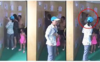 當工作人員打開儲物櫃的櫃門,媽媽從櫃中抱出了嚶嚶啼哭的孩子。(視頻截圖/大紀元合成)